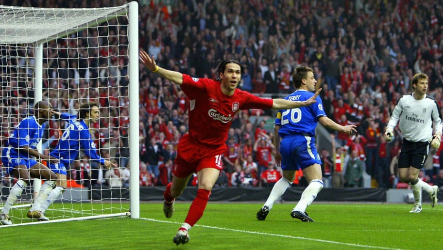 LIVERPOOL, United Kingdom:  Sequence 7 of 7 - Liverpool's Luis Garcia (C) celebrates scoring a goal as Chelsea's William Gallas (L) tried to clear the ball alongside Ricardo Carvalho (2nd L) in the goal while John Terry (C back) and goalkeeper Petr Cech (2nd R) and Milan Baros (R) look on during the Champions League semi-final second leg football match at Anfield in Liverpool 02 May 2005. The ball was cleared from the goalline by Gallas but the ball was judged to have crossed the line for the only goal of the game. Liverpool won 1-0 to advance to the final. AFP PHOTO ADRIAN DENNIS  (Photo credit should read ADRIAN DENNIS/AFP/Getty Images)
