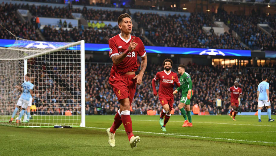 MANCHESTER, ENGLAND - APRIL 10:  Roberto Firmino of Liverpool celebrates scoring the second goal during the Quarter Final Second Leg match between Manchester City and Liverpool at Etihad Stadium on April 10, 2018 in Manchester, England.  (Photo by Laurence Griffiths/Getty Images,)