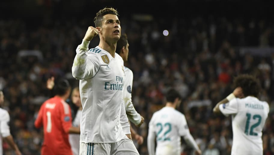 Real Madrid's Portuguese forward Cristiano Ronaldo celebrates during the UEFA Champions League quarter-final second leg football match between Real Madrid CF and Juventus FC at the Santiago Bernabeu stadium in Madrid on April 11, 2018. / AFP PHOTO / PIERRE-PHILIPPE MARCOU        (Photo credit should read PIERRE-PHILIPPE MARCOU/AFP/Getty Images)