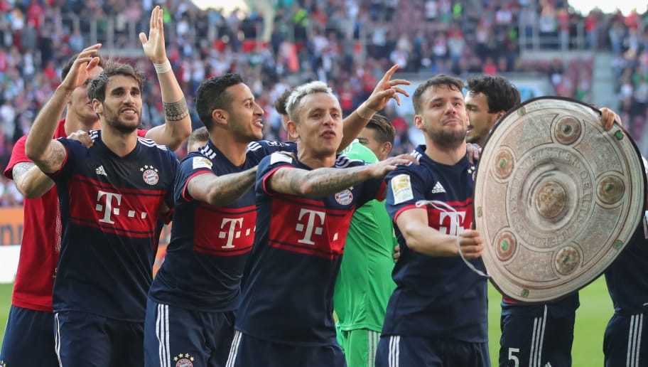 AUGSBURG, GERMANY - APRIL 07:  Juan Bernat of Muenchen leads the team as they celebrate in front of their supporters, winning the Bundesliga championship, after the Bundesliga match between FC Augsburg and FC Bayern Muenchen at WWK-Arena on April 7, 2018 in Augsburg, Germany.  (Photo by Alexander Hassenstein/Bongarts/Getty Images)