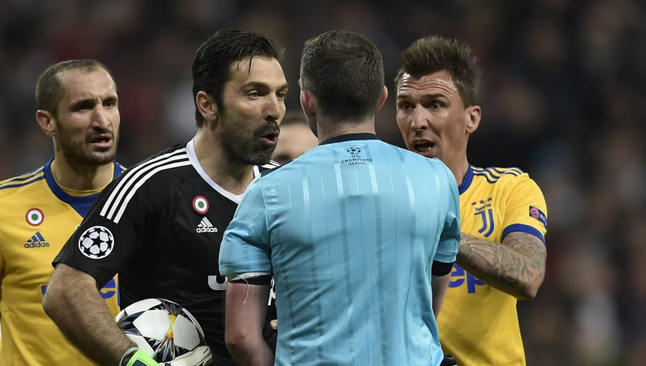 Juventus' Italian goalkeeper Gianluigi Buffon (2L) argues with the referee during the UEFA Champions League quarter-final second leg football match between Real Madrid CF and Juventus FC at the Santiago Bernabeu stadium in Madrid on April 11, 2018. / AFP PHOTO / OSCAR DEL POZO        (Photo credit should read OSCAR DEL POZO/AFP/Getty Images)