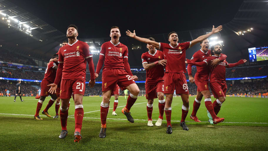 MANCHESTER, ENGLAND - APRIL 10:  l-r Alex Oxlade-Chamberlain, Andy Robertson, Roberto Firmino, Trent Alexander-Arnold, Virgil Van Dijk and goal scorer, Mohamed Salah of Liverpool celebrate the their first goal during the Quarter Final Second Leg match between Manchester City and Liverpool at Etihad Stadium on April 10, 2018 in Manchester, England.  (Photo by Laurence Griffiths/Getty Images,)
