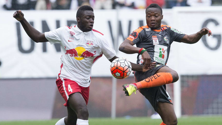SALZBURG, AUSTRIA - MAY 15: Dayot Upamecano of Salzburg challenges Issiaka Ouedraogo of Wolfsberg during the tipico Bundesliga match between Red Bull Salzburg and Wolfsburger AC at Red Bull Arena on May 15, 2016 in Salzburg, Austria.  (Photo by Andreas Schaad/Bongarts/Getty Images)