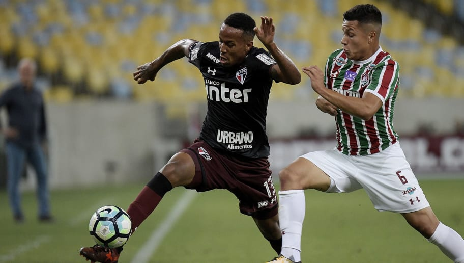 RIO DE JANEIRO, BRAZIL - OCTOBER 18: Marlon (R) of Fluminense battles for the ball with Militão of Sao Paulo  during the match between Fluminense and Sao Paulo as part of Brasileirao Series A 2017 at Maracana Stadium on October 18, 2017 in Rio de Janeiro, Brazil. (Photo by Alexandre Loureiro/Getty Images)