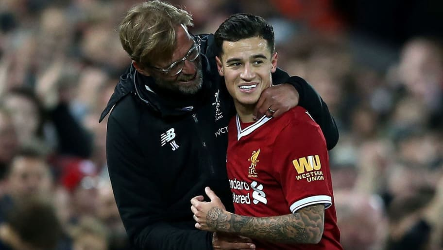 LIVERPOOL, ENGLAND - NOVEMBER 18:  Philippe Coutinho of Liverpool is congratulated by manager Jurgen Klopp after scoring his side's third goal during the Premier League match between Liverpool and Southampton at Anfield on November 18, 2017 in Liverpool, England.  (Photo by Jan Kruger/Getty Images)