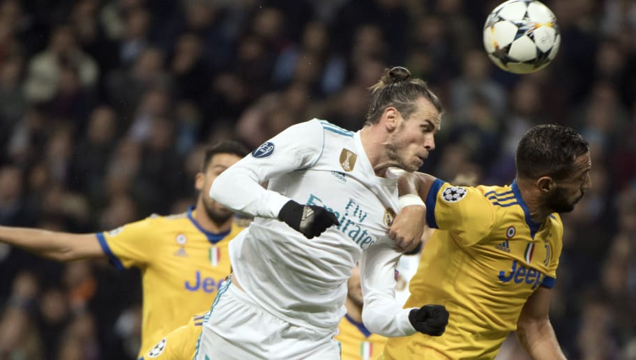 Real Madrid's Welsh forward Gareth Bale (L) vies with Juventus' Italian defender Medhi Benatia during the UEFA Champions League quarter-final second leg football match between Real Madrid CF and Juventus FC at the Santiago Bernabeu stadium in Madrid on April 11, 2018. / AFP PHOTO / Curto DE LA TORRE        (Photo credit should read CURTO DE LA TORRE/AFP/Getty Images)