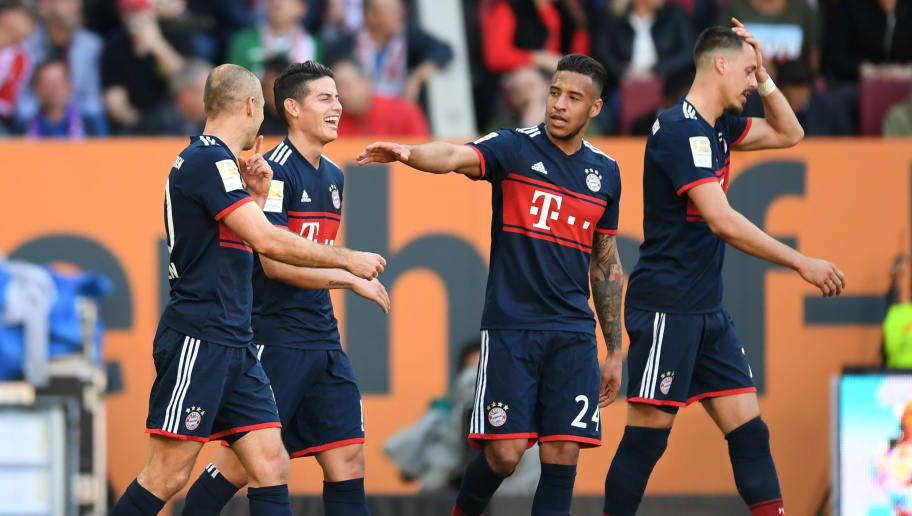 (L-R) Bayern Munich's Dutch midfielder Arjen Robben, Bayern Munich's Colombian James Rodriguez, Bayern Munich's French midfielder Corentin Tolisso and Bayern Munich's defender Niklas Suele react after the third goal during the German first division Bundesliga football match FC Augsburg vs FC Bayern Munich in Augsburg, southern Germany, on April 7, 2018. / AFP PHOTO / Christof STACHE / RESTRICTIONS: DURING MATCH TIME: DFL RULES TO LIMIT THE ONLINE USAGE TO 15 PICTURES PER MATCH AND FORBID IMAGE SEQUENCES TO SIMULATE VIDEO. == RESTRICTED TO EDITORIAL USE == FOR FURTHER QUERIES PLEASE CONTACT DFL DIRECTLY AT + 49 69 650050         (Photo credit should read CHRISTOF STACHE/AFP/Getty Images)
