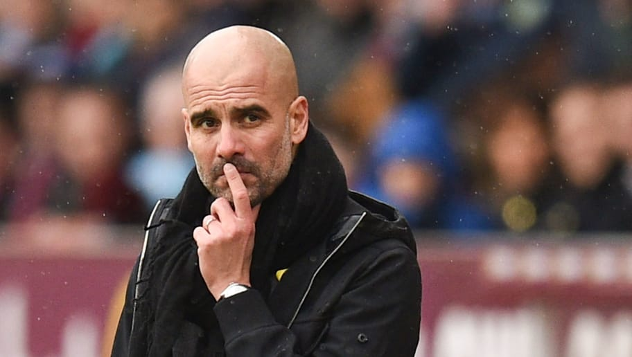 Manchester City's Spanish manager Pep Guardiola reacts on the touchline during the English Premier League football match between Burnley and Manchester City at Turf Moor in Burnley, north west England on February 3, 2018. / AFP PHOTO / Oli SCARFF / RESTRICTED TO EDITORIAL USE. No use with unauthorized audio, video, data, fixture lists, club/league logos or 'live' services. Online in-match use limited to 75 images, no video emulation. No use in betting, games or single club/league/player publications.  /         (Photo credit should read OLI SCARFF/AFP/Getty Images)