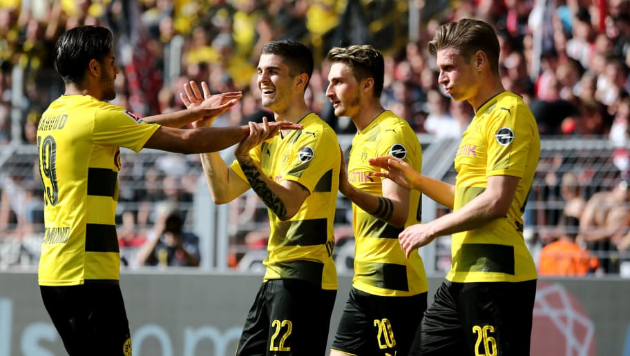 DORTMUND, GERMANY - APRIL 08: Christian Pulisic of Dortmund (2nd L) celebrates the first goal with Mahmoud Dahoud of Dortmund (L) during the Bundesliga match between Borussia Dortmund and VfB Stuttgart at Signal Iduna Park on April 8, 2018 in Dortmund, Germany. (Photo by Christof Koepsel/Bongarts/Getty Images)