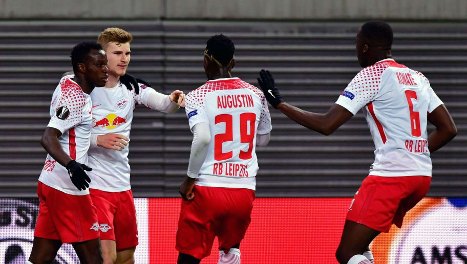 Leipzig's German forward Timo Werner (2ndd L) celebrates scoring the opening goal with his teammates during the UEFA Europa League quarter-final first leg football match RB Leipzig vs Olympique de Marseille (OM) at the RB arena in Leipzig, eastern Germany, on April 5, 2018. / AFP PHOTO / John MACDOUGALL        (Photo credit should read JOHN MACDOUGALL/AFP/Getty Images)