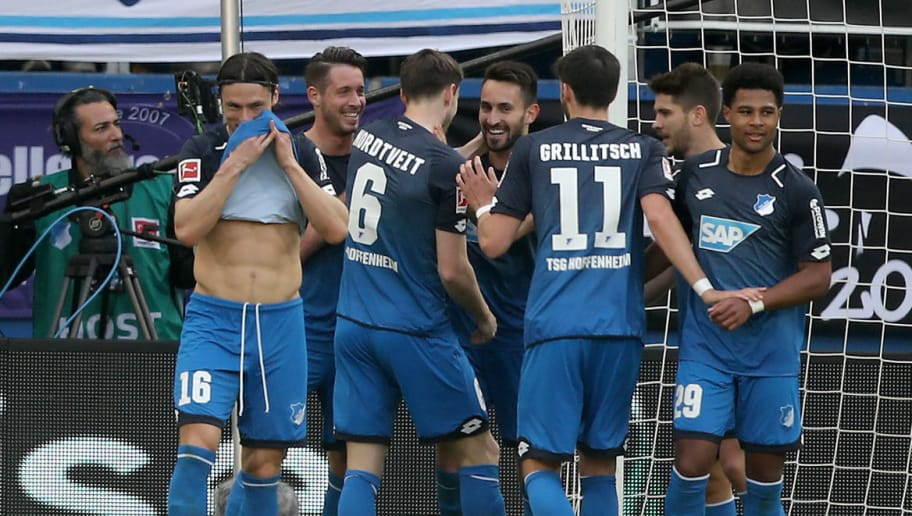 SINSHEIM, GERMANY - MARCH 31: Lukas Rupp of Hoffenheim (C) celebrates the forth goal with his team mates during the Bundesliga match between TSG 1899 Hoffenheim and 1. FC Koeln at Wirsol Rhein-Neckar-Arena on March 31, 2018 in Sinsheim, Germany.