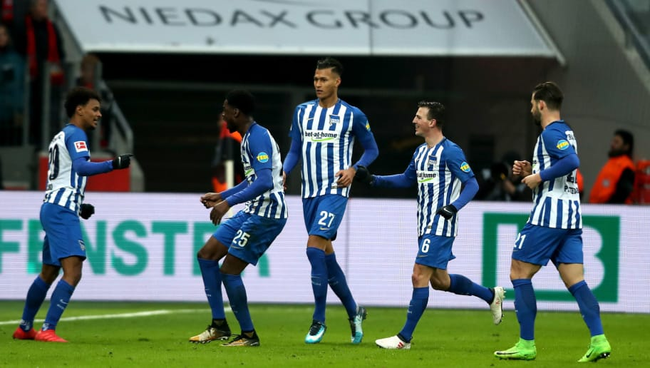 LEVERKUSEN, GERMANY - FEBRUARY 10:  Valentino Lazaro of Berlin (L) celebrates the first goal with his team mates during the Bundesliga match between Bayer 04 Leverkusen and Hertha BSC at BayArena on February 10, 2018 in Leverkusen, Germany. (Photo by Christof Koepsel/Bongarts/Getty Images)