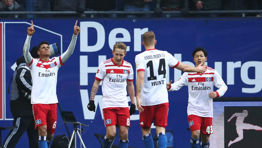HAMBURG, GERMANY - MARCH 17:  Douglas Santos (L) of Hamburg celebrates after scoring their first goal during the Bundesliga match between Hamburger SV and Hertha BSC at Volksparkstadion on March 17, 2018 in Hamburg, Germany.  (Photo by Oliver Hardt/Bongarts/Getty Images)