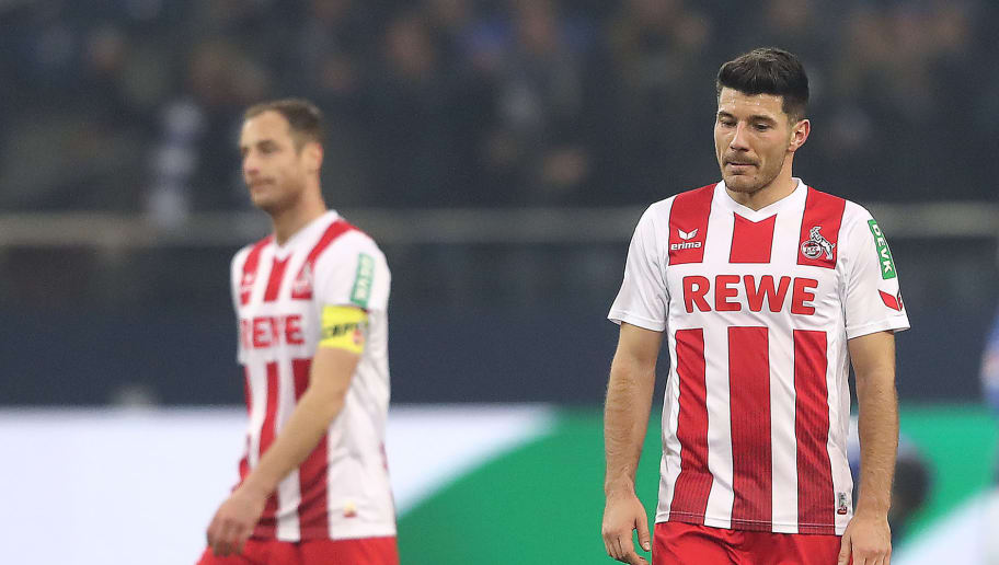 GELSENKIRCHEN, GERMANY - DECEMBER 02: Matthias Lehmann of Koeln (l) and Milos Jojic of Koeln dejected after Schalke scored their first goal during the Bundesliga match between FC Schalke 04 and 1. FC Koeln at Veltins-Arena on December 2, 2017 in Gelsenkirchen, Germany. (Photo by Christof Koepsel/Bongarts/Getty Images)