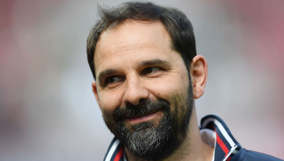 COLOGNE, GERMANY - APRIL 07: Stefan Ruthenbeck, coach of Koeln, smiles before the Bundesliga match between 1. FC Koeln and 1. FSV Mainz 05 at RheinEnergieStadion on April 7, 2018 in Cologne, Germany. (Photo by Matthias Hangst/Bongarts/Getty Images)