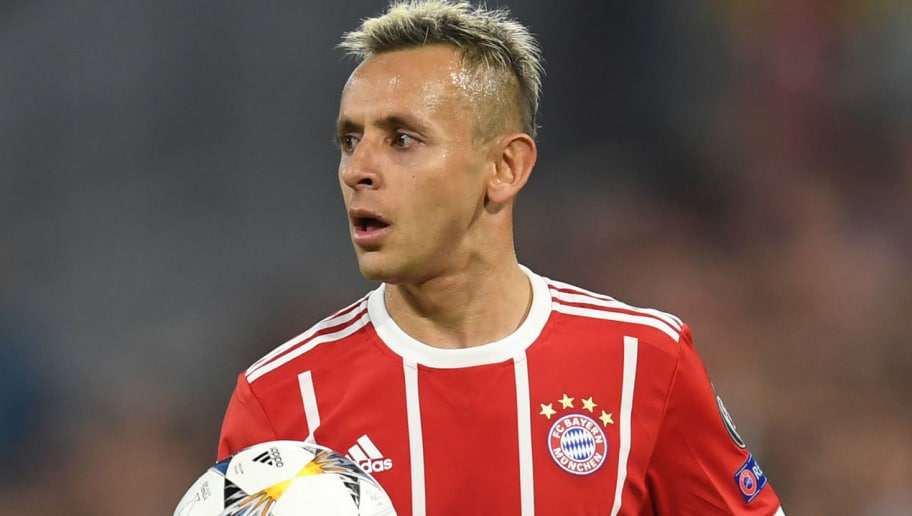 Bayern Munich's Brazilian defender Rafinha holds the ball prior a throw-in during the UEFA Champions League quarter-final second leg football match between FC Bayern Munich and Sevilla FC on April 11, 2018 in Munich, southern Germany. Bayern Munich marched into another Champions League semi-final despite 10-man Sevilla holding them to a goalless draw at home. / AFP PHOTO / Christof STACHE        (Photo credit should read CHRISTOF STACHE/AFP/Getty Images)