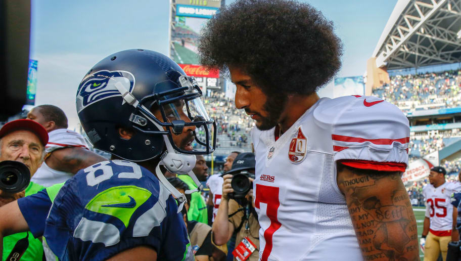 SEATTLE, WA - SEPTEMBER 25:  Quarterback Colin Kaepernick #7 of the San Francisco 49ers talks with wide receiver Doug Baldwin #89 of the Seattle Seahawks after the game at CenturyLink Field on September 25, 2016 in Seattle, Washington.  (Photo by Otto Greule Jr/Getty Images)