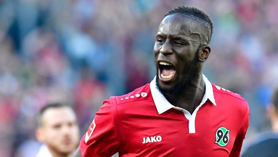 Hanover's Senegalese defender Salif Sane (R) reacts after scoring during the German First division Bundesliga football match Hannover 96 vs Eintracht Frankfurt in Hanover, central Germany, on October 14, 2017. / AFP PHOTO / Tobias SCHWARZ / RESTRICTIONS: DURING MATCH TIME: DFL RULES TO LIMIT THE ONLINE USAGE TO 15 PICTURES PER MATCH AND FORBID IMAGE SEQUENCES TO SIMULATE VIDEO. == RESTRICTED TO EDITORIAL USE == FOR FURTHER QUERIES PLEASE CONTACT DFL DIRECTLY AT + 49 69 650050         (Photo credit should read TOBIAS SCHWARZ/AFP/Getty Images)