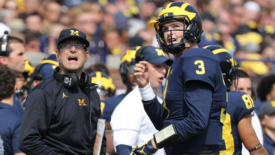 ANN ARBOR, MI - SEPTEMBER 16: Michigan Wolverines head football coach Jim Harbaugh and starting quarterback Wilton Speight #3 watch the video replay during the first quarter of the game against the Air Force Falcons at Michigan Stadium on September 16, 2017 in Ann Arbor, Michigan.(Photo by Leon Halip/Getty Images)