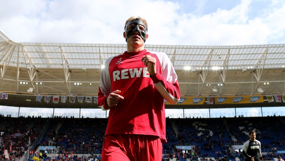 SINSHEIM, GERMANY - MARCH 31: Frederik Soerensen of Koeln warms up with a face mask prior to the Bundesliga match between TSG 1899 Hoffenheim and 1. FC Koeln at Wirsol Rhein-Neckar-Arena on March 31, 2018 in Sinsheim, Germany.