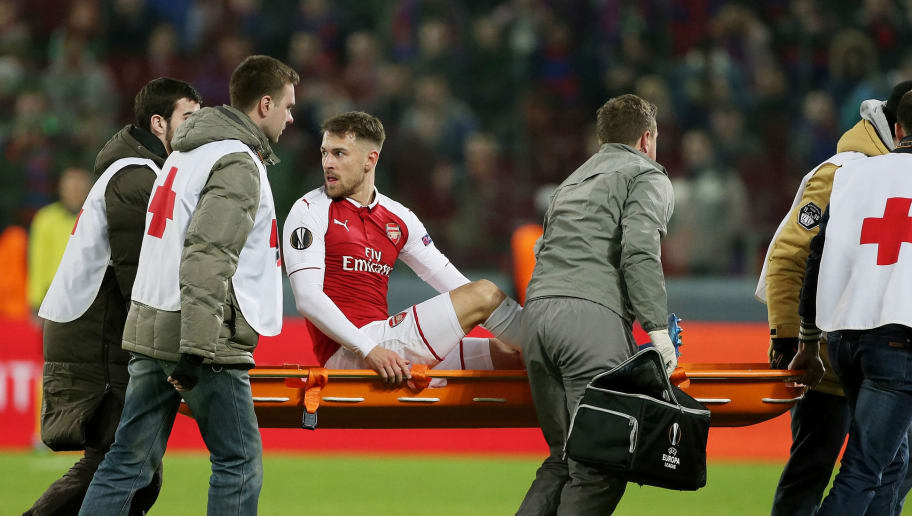 MOSCOW, RUSSIA - APRIL 12: Aaron Ramsey of Arsenal is stretchered from the pitch during the UEFA Europa League quarter final leg two match between PFC CSKA Moskva and Arsenal FC at CSKA Arena stadium on April 12, 2018 in Moscow, Russia. (Photo by Oleg Nikishin/Getty Images)