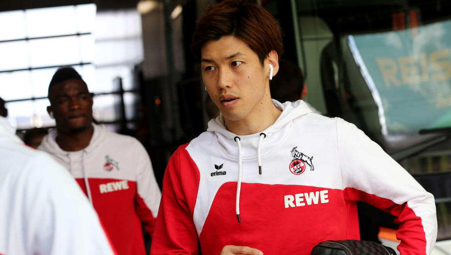 SINSHEIM, GERMANY - MARCH 31: Yuya Osako of Koeln walks out of the bus prior to the Bundesliga match between TSG 1899 Hoffenheim and 1. FC Koeln at Wirsol Rhein-Neckar-Arena on March 31, 2018 in Sinsheim, Germany.