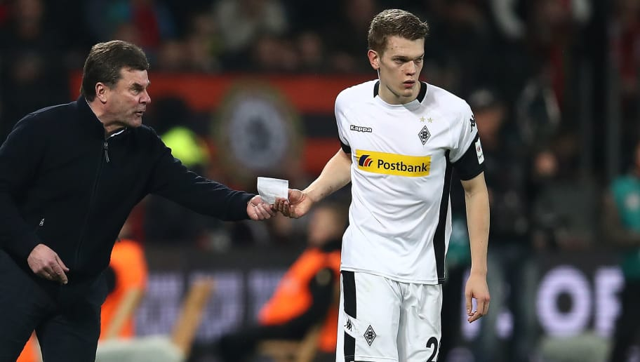 LEVERKUSEN, GERMANY - MARCH 10: Matthias Ginter of Moenchengladbach (r) is handed a piece of paper by Dieter Hecking, coach of Moenchengladbach, during the Bundesliga match between Bayer 04 Leverkusen and Borussia Moenchengladbach at BayArena on March 10, 2018 in Leverkusen, Germany. (Photo by Maja Hitij/Bongarts/Getty Images)