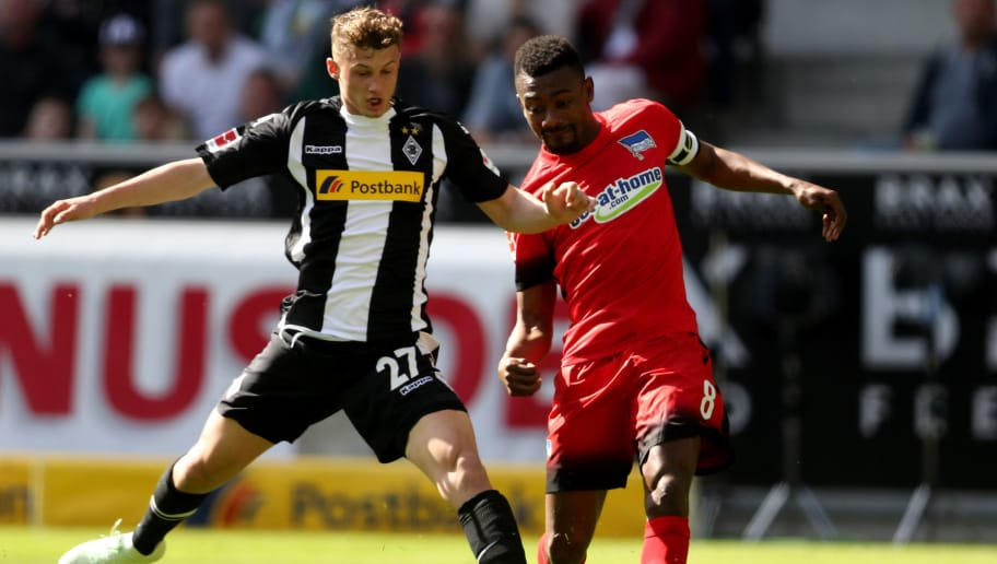 MOENCHENGLADBACH, GERMANY - APRIL 07: (L-R) Mickael Cuisance of Moenchengladbach challenges Salomon Kalou of Berlin during the Bundesliga match between Borussia Moenchengladbach and Hertha BSC at Borussia-Park on April 7, 2018 in Moenchengladbach, Germany. (Photo by Christof Koepsel/Bongarts/Getty Images)