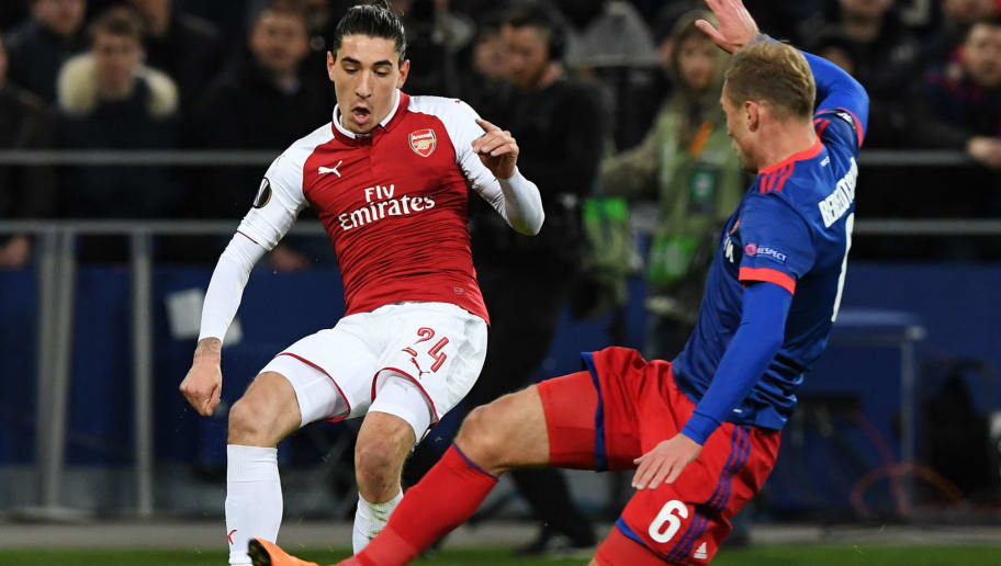 CSKA Moscow's Russian defender Aleksei Berezutski (R) vies Arsenal's Spanish defender Hector Bellerin during the UEFA Europa League second leg quarter-final football match between CSKA Moscow and Arsenal at the VEB Arena stadium in Moscow on April 12, 2018. / AFP PHOTO / Kirill KUDRYAVTSEV        (Photo credit should read KIRILL KUDRYAVTSEV/AFP/Getty Images)