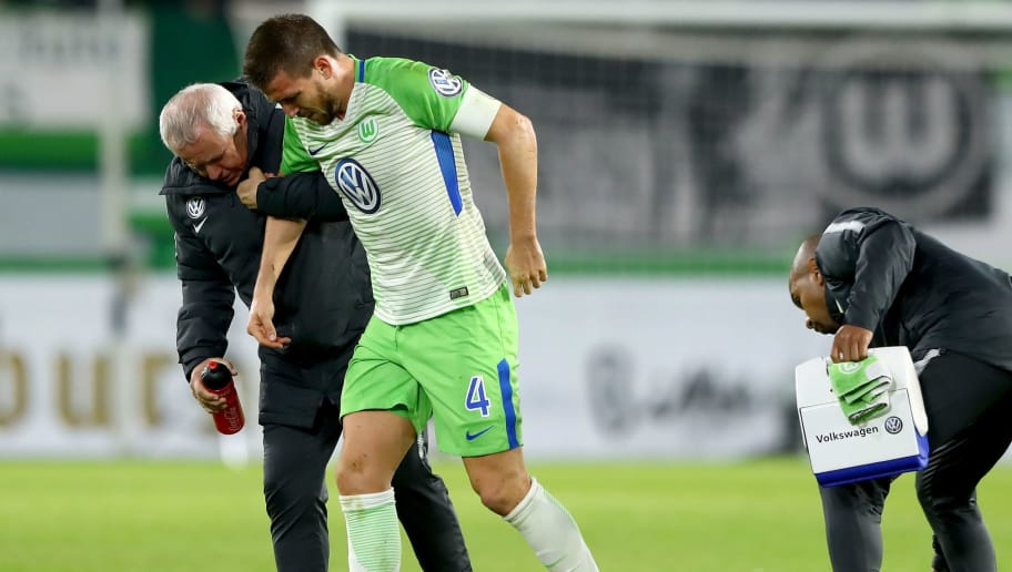 WOLFSBURG, GERMANY - OCTOBER 25: Ignacio Camacho of Wolfsburg walks injured off the pitch during the DFB Cup match between VfL Wolfsburg and Hannover 96 at Volkswagen Arena on October 25, 2017 in Wolfsburg, Germany.  (Photo by Martin Rose/Bongarts/Getty Images)