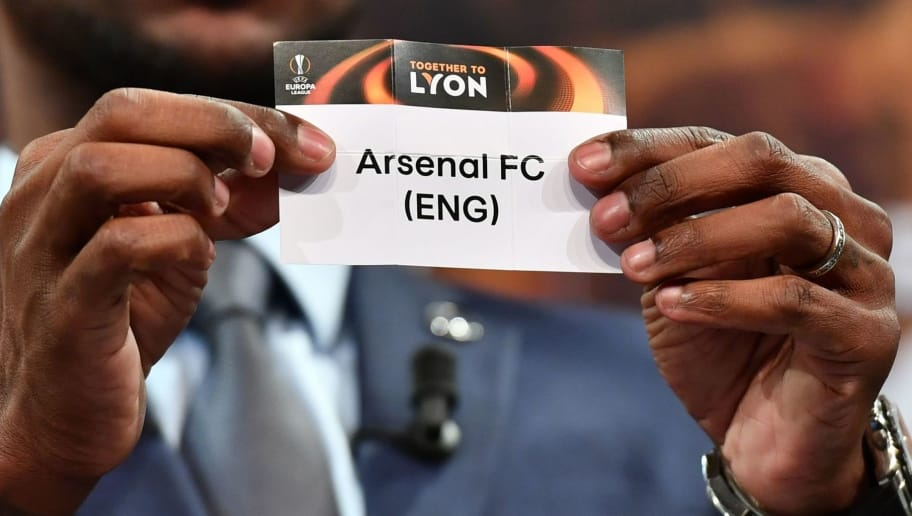 French former football player for Barcelona and Lyon Eric Abidal shows the slip of Arsenal FC during the draw for the quarter finals round of the UEFA Europa League football tournament at the UEFA headquarters in Nyon, on March 16, 2018. / AFP PHOTO / Fabrice COFFRINI        (Photo credit should read FABRICE COFFRINI/AFP/Getty Images)