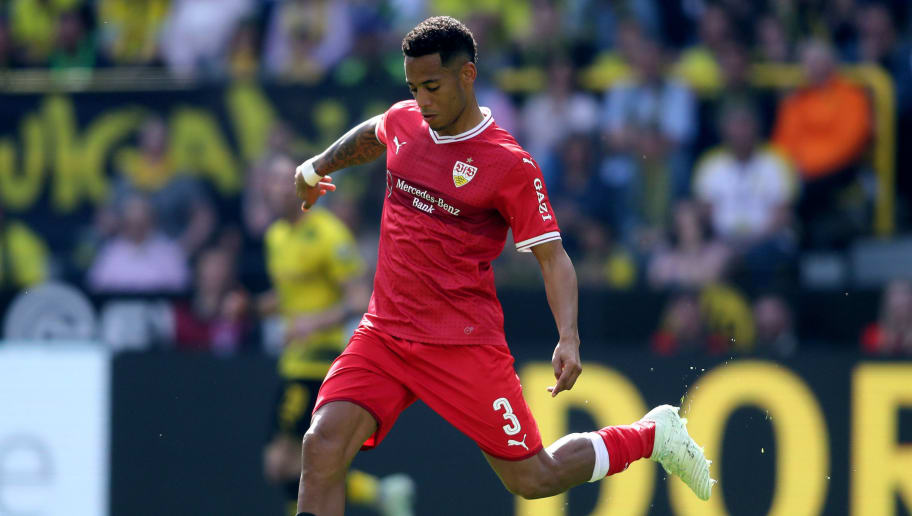 DORTMUND, GERMANY - APRIL 08: Dennis Aogo of Stuttgart runs with the ball during the Bundesliga match between Borussia Dortmund and VfB Stuttgart at Signal Iduna Park on April 8, 2018 in Dortmund, Germany. The match between Dortmund and Stuttgart ended 3-0. (Photo by Christof Koepsel/Bongarts/Getty Images)