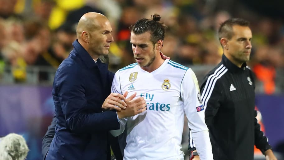 DORTMUND, GERMANY - SEPTEMBER 26: Gareth Bale of Real Madrid and Zinedine Zidane, Manager of Real Madrid embrace after he is subbed during the UEFA Champions League group H match between Borussia Dortmund and Real Madrid at Signal Iduna Park on September 26, 2017 in Dortmund, Germany.  (Photo by Martin Rose/Bongarts/Getty Images)