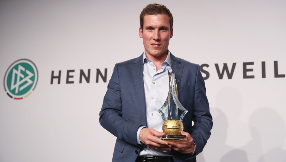 NEU ISENBURG, GERMANY - MARCH 19:  Hannes Wolf poses after being awarded 'Coach of the Year' during the Coaching Award Ceremony & Closing Event UEFA Pro Coaching Course 2017/2018 at Kempinski Hotel Frankfurt on March 19, 2018 in Neu Isenburg, Germany.  (Photo by Alex Grimm/Bongarts/Getty Images)