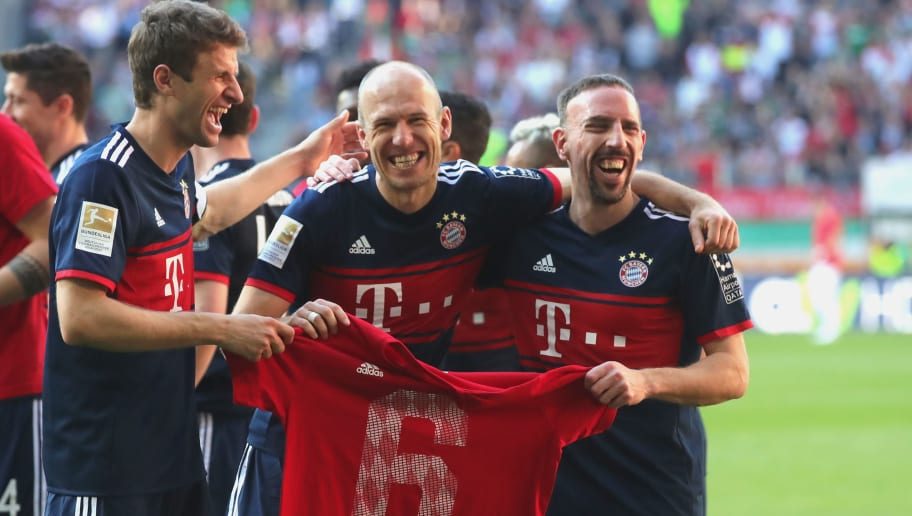 AUGSBURG, GERMANY - APRIL 07:  (R-L:) Franck Ribery of Bayern Muenchen, Arjen Robben of Bayern Muenchen and Thomas Mueller of Bayern Muenchen display a shirt showing a 6 after they won the 6th championship back to back, after the Bundesliga match between FC Augsburg and FC Bayern Muenchen at WWK-Arena on April 7, 2018 in Augsburg, Germany.  (Photo by Alexander Hassenstein/Bongarts/Getty Images)