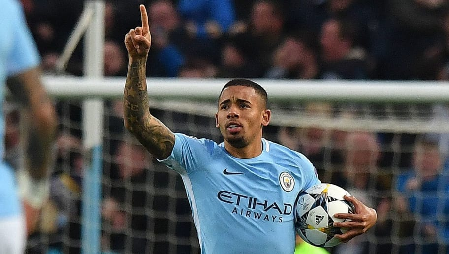 Manchester City's Brazilian striker Gabriel Jesus celebrates scoring the opening goal during the UEFA Champions League second leg quarter-final football match between Manchester City and Liverpool, at the Etihad Stadium in Manchester, north west England on April 10, 2018. / AFP PHOTO / Anthony Devlin        (Photo credit should read ANTHONY DEVLIN/AFP/Getty Images)