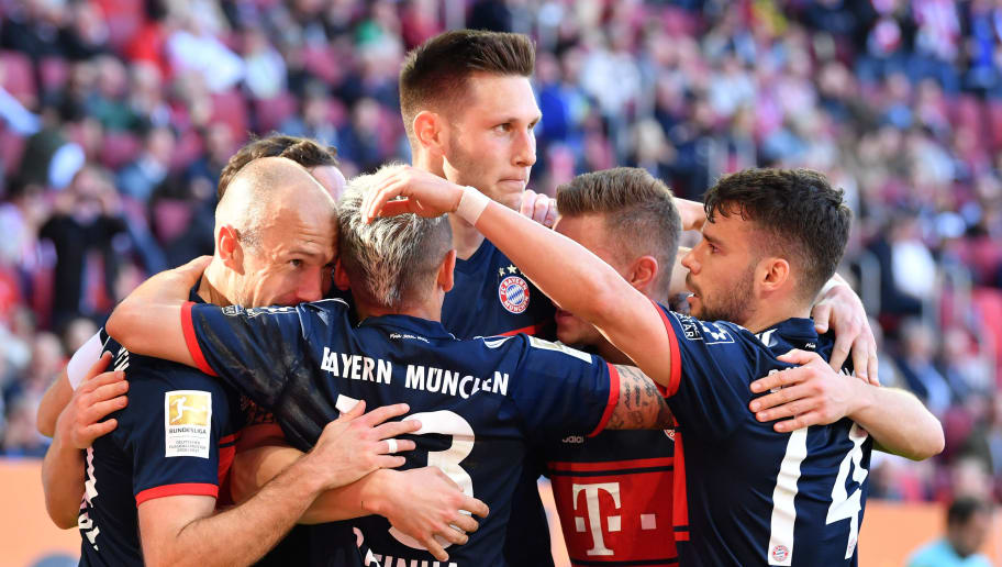 AUGSBURG, GERMANY - APRIL 07: Arjen Robben of Bayern Muenchen celebrates with teammates after he scored his teams third goal during the Bundesliga match between FC Augsburg and FC Bayern Muenchen at WWK-Arena on April 7, 2018 in Augsburg, Germany. (Photo by Sebastian Widmann/Bongarts/Getty Images)