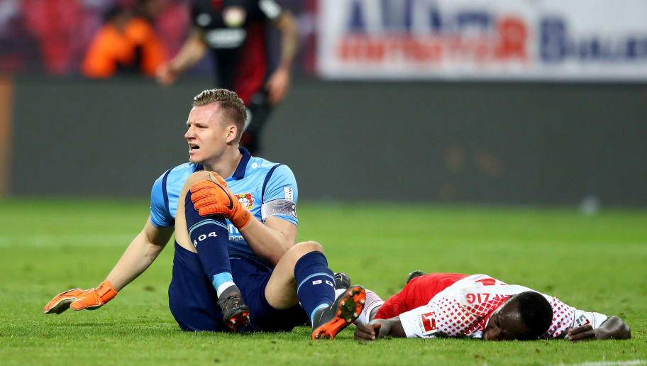 LEIPZIG, GERMANY - APRIL 09:  Bernd Leno, goalkeeper of Leverkusen and Naby Deco Keita of Leipzig lying injured on the pitch during the Bundesliga match between RB Leipzig and Bayer 04 Leverkusen at Red Bull Arena on April 9, 2018 in Leipzig, Germany.  (Photo by Martin Rose/Bongarts/Getty Images)