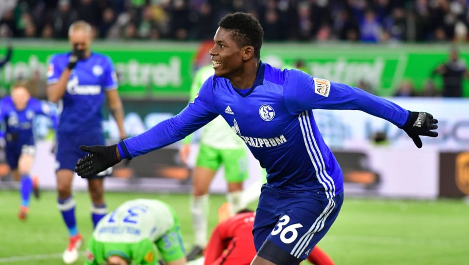 Schalke's Swiss forward Breel Embolo celebrates after instigating an own goal by Wolfsburg's German defender Robin Knoche (2L) during the German First division Bundesliga football match VfL Wolfsburg vs Schalke 04, in Wolfsburg, on March 17, 2018. / AFP PHOTO / John MACDOUGALL / RESTRICTIONS: DURING MATCH TIME: DFL RULES TO LIMIT THE ONLINE USAGE TO 15 PICTURES PER MATCH AND FORBID IMAGE SEQUENCES TO SIMULATE VIDEO. == RESTRICTED TO EDITORIAL USE == FOR FURTHER QUERIES PLEASE CONTACT DFL DIRECTLY AT + 49 69 650050  / RESTRICTIONS: DURING MATCH TIME: DFL RULES TO LIMIT THE ONLINE USAGE TO 15 PICTURES PER MATCH AND FORBID IMAGE SEQUENCES TO SIMULATE VIDEO. == RESTRICTED TO EDITORIAL USE == FOR FURTHER QUERIES PLEASE CONTACT DFL DIRECTLY AT + 49 69 650050        (Photo credit should read JOHN MACDOUGALL/AFP/Getty Images)