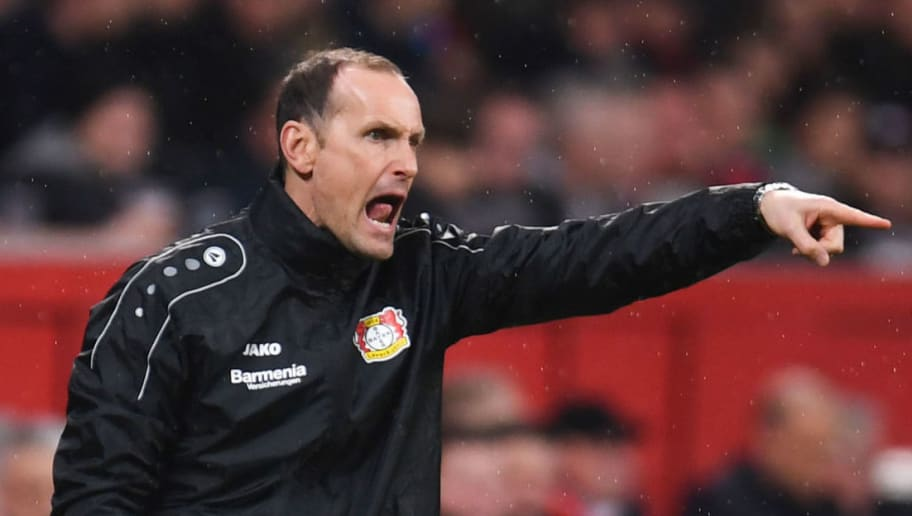 Leverkusen's German head coach Heiko Herrlich reacts during the German first division Bundesliga football match Bayer 04 Leverkusen vs Borussia Moenchengladbach, in Leverkusen, western Germany, on March 10, 2018. / AFP PHOTO / Patrik STOLLARZ / RESTRICTIONS: DURING MATCH TIME: DFL RULES TO LIMIT THE ONLINE USAGE TO 15 PICTURES PER MATCH AND FORBID IMAGE SEQUENCES TO SIMULATE VIDEO. == RESTRICTED TO EDITORIAL USE == FOR FURTHER QUERIES PLEASE CONTACT DFL DIRECTLY AT + 49 69 650050         (Photo credit should read PATRIK STOLLARZ/AFP/Getty Images)