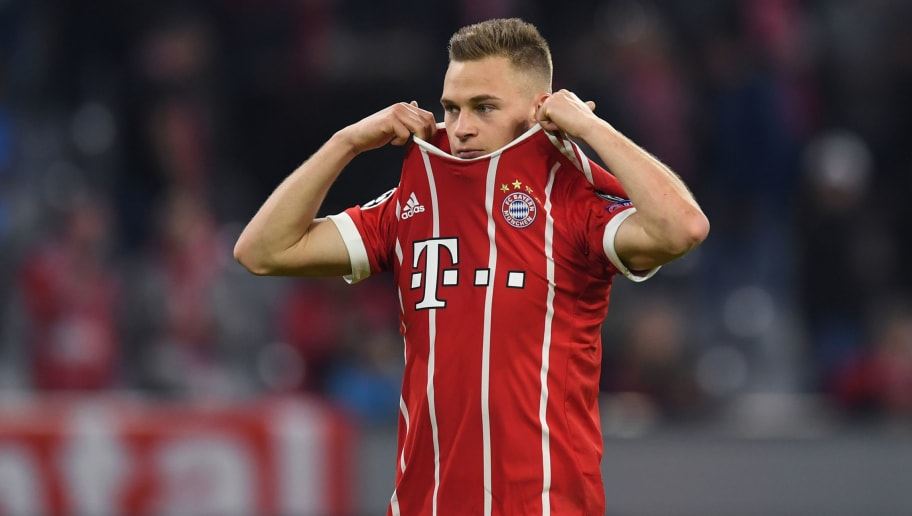 Bayern Munich's German midfielder Joshua Kimmich takes off his shirt after the UEFA Champions League quarter-final second leg football match between FC Bayern Munich and Sevilla FC on April 11, 2018 in Munich, southern Germany. Bayern Munich marched into another Champions League semi-final despite 10-man Sevilla holding them to a goalless draw at home. / AFP PHOTO / Christof STACHE        (Photo credit should read CHRISTOF STACHE/AFP/Getty Images)