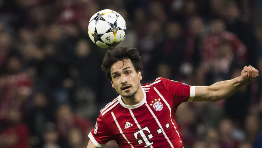 Bayern Munich's German defender Mats Hummels heads the ball during the UEFA Champions League quarter-final second leg football match between Bayern Munich and Sevilla FC on April 11, 2018 in Munich, southern Germany. / AFP PHOTO / Odd ANDERSEN        (Photo credit should read ODD ANDERSEN/AFP/Getty Images)