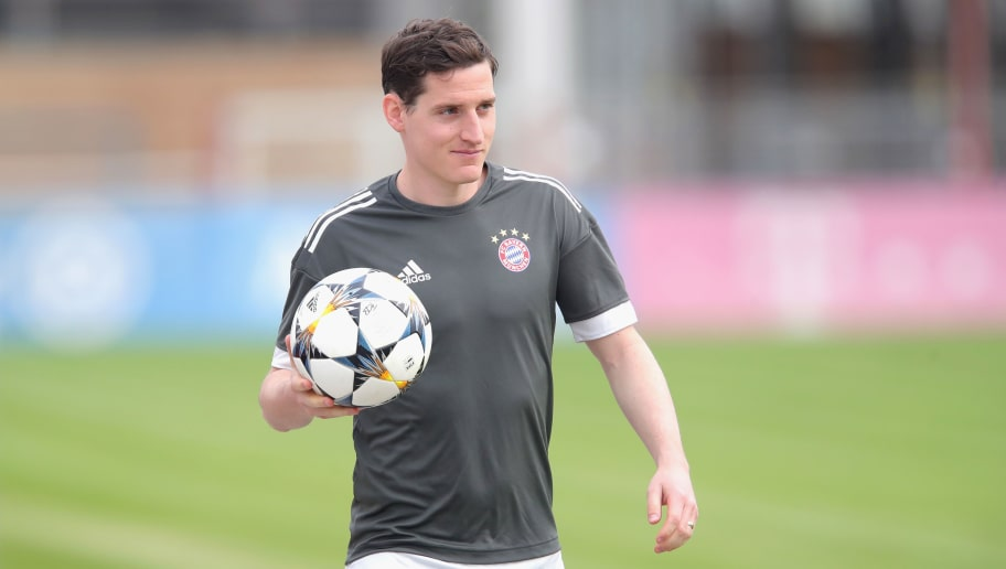 MUNICH, GERMANY - APRIL 10:  Sebastian Rudy of Bayern Muenchen  looks on during a Bayern Muenchen training session ahead of the UEFA Champions League 2nd leg quaterfinale match against Sevilla at Saebener Strasse training ground on April 10, 2018 in Munich, Germany.  (Photo by Alexander Hassenstein/Bongarts/Getty Images)