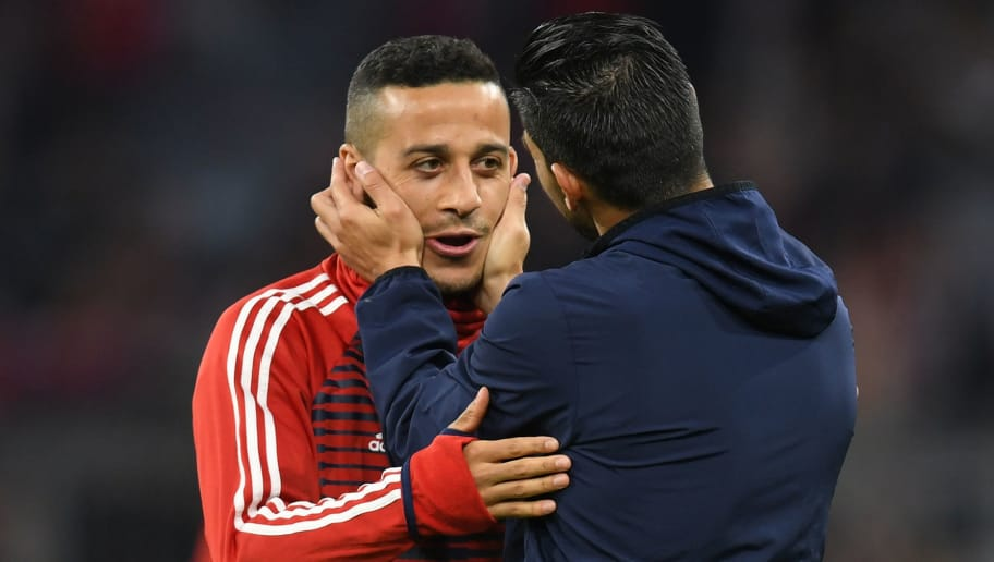 Sevilla's Spanish forward Nolito (R) greets Bayern Munich's Spanish midfielder Thiago Alcantara prior to the UEFA Champions League quarter-final second leg football match between FC Bayern Munich and Sevilla FC on April 11, 2018 in Munich, southern Germany. / AFP PHOTO / Christof STACHE        (Photo credit should read CHRISTOF STACHE/AFP/Getty Images)