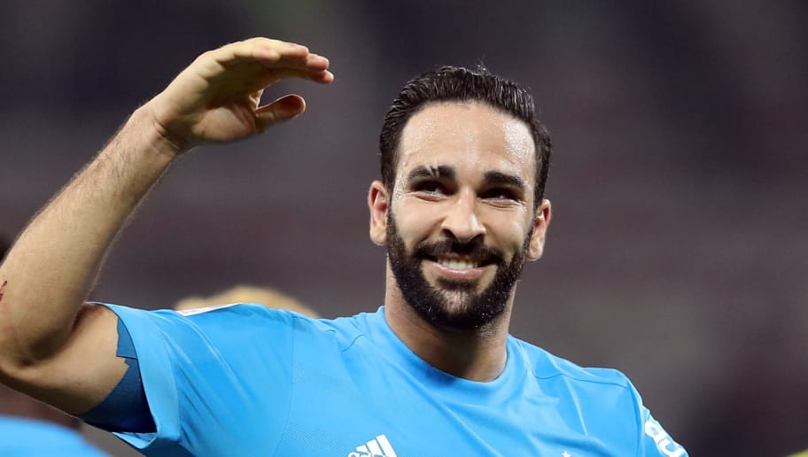 Olympique de Marseille's French defender Adil Rami reacts at the end of French L1 football match between Nice and Marseille on October 1, 2017 at the 'Allianz Riviera' stadium in Nice, southeastern France. / AFP PHOTO / VALERY HACHE        (Photo credit should read VALERY HACHE/AFP/Getty Images)