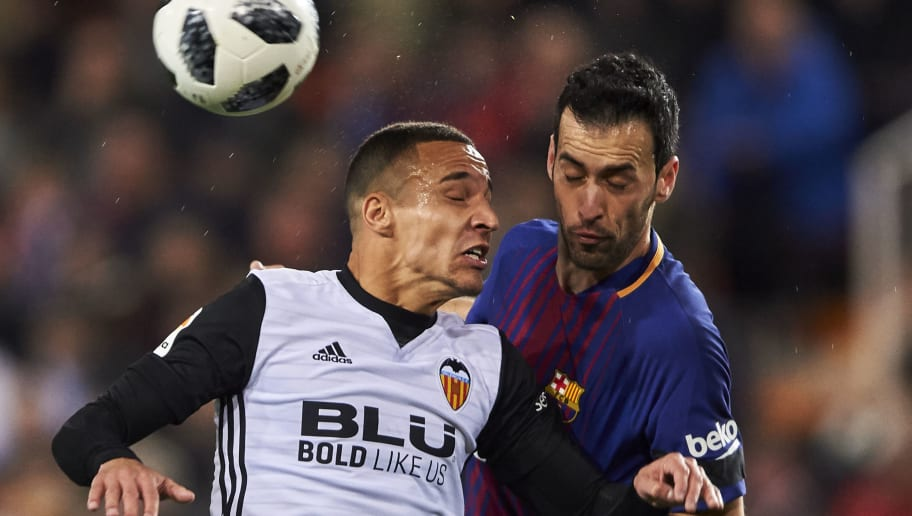 VALENCIA, SPAIN - FEBRUARY 08:  Rodrigo Moreno of Valencia CF competes for the ball with Sergio Busquets of FC Barcelona during the Copa de Rey semi-final second leg match between Valencia and Barcelona on February 8, 2018 in Valencia, Spain.  (Photo by Manuel Queimadelos Alonso/Getty Images)