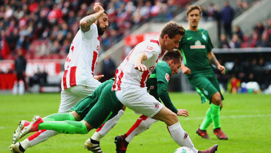 COLOGNE, GERMANY - OCTOBER 22:  Izet Hajrovic of Werder Bremen battles for the ball with Lukas Klunter and Dominic Maroh of FC Koeln during the Bundesliga match between 1. FC Koeln and SV Werder Bremen held at RheinEnergieStadion on October 22, 2017 in Cologne, Germany.  (Photo by Dean Mouhtaropoulos/Bongarts/Getty Images)