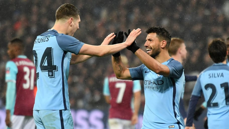 Manchester City's Argentinian striker Sergio Aguero (3rd R) celebrates with Manchester City's English defender John Stones after scoring their fourth goal during the English FA cup third round football match between West Ham United and Manchester City at the London Stadium in east London on January 6, 2017.  / AFP / Justin TALLIS / RESTRICTED TO EDITORIAL USE. No use with unauthorized audio, video, data, fixture lists, club/league logos or 'live' services. Online in-match use limited to 75 images, no video emulation. No use in betting, games or single club/league/player publications.  /         (Photo credit should read JUSTIN TALLIS/AFP/Getty Images)