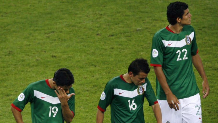 Leipzig, GERMANY:  Mexican forward Omar Bravo (L) Mexican defender Mario Mendez (C) and Mexican defender Francisco Rodriguez (R) look dejected at the end of the World Cup 2006 round of 16 football game Argentina vs. Mexico, 24 June 2006 at Leipzig stadium. Argentina won 2 to 1 after the extra time and is qualifyed for the next round. Mexico is out of the competion.   AFP PHOTO / ARIS MESSINIS  (Photo credit should read ARIS MESSINIS/AFP/Getty Images)