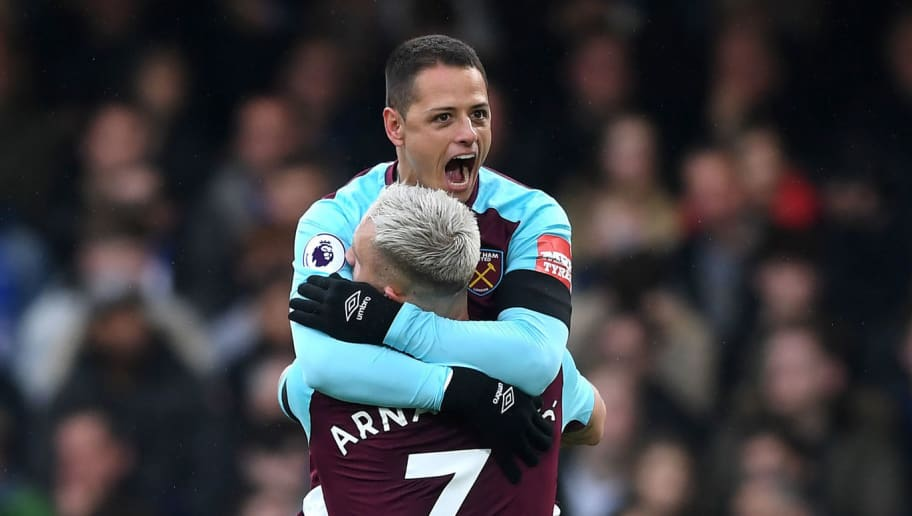 LONDON, ENGLAND - APRIL 08:  Javier Hernandez of West Ham United celebrates with team mate Marko Arnautovic of West Ham United after scoring his sides first goal during the Premier League match between Chelsea and West Ham United at Stamford Bridge on April 8, 2018 in London, England.  (Photo by Shaun Botterill/Getty Images)
